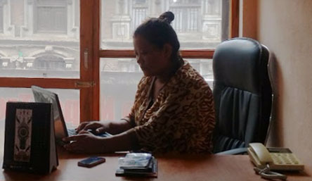 Female tourism entrepreneur Kopila Sen working at office of iTourNepal.com P Ltd