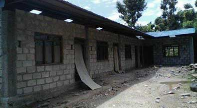 rebuilding primary school destroyed by earthquake.